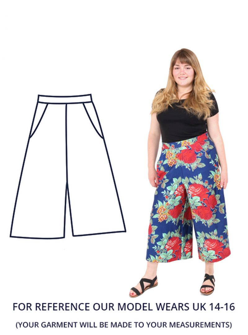 Model Charlotte wearing a royal blue pair of culottes with a large red floral print. Charlotte is wearing a size UK 14-16.