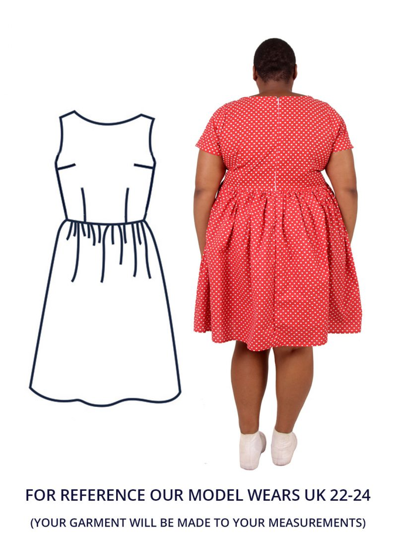 Nyome is stood with her back to the camera and is wearing a red tea dress with a cute heart print.