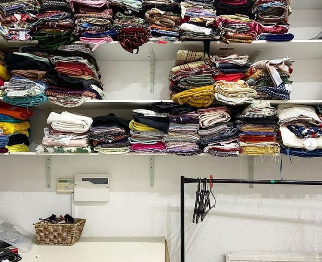 Image of the Emperor's studio featuring our shelves of fabrics in one of our sewing rooms.